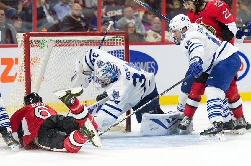Sep 21, 2015; Ottawa, Ontario, CAN; Toronto Maple Leafs goalie James Reimer (34) makes a save in front of Ottawa Senators right wing Bobby Ryan (6) in the second period at Canadian Tire Centre. Mandatory Credit: Marc DesRosiers-USA TODAY Sports