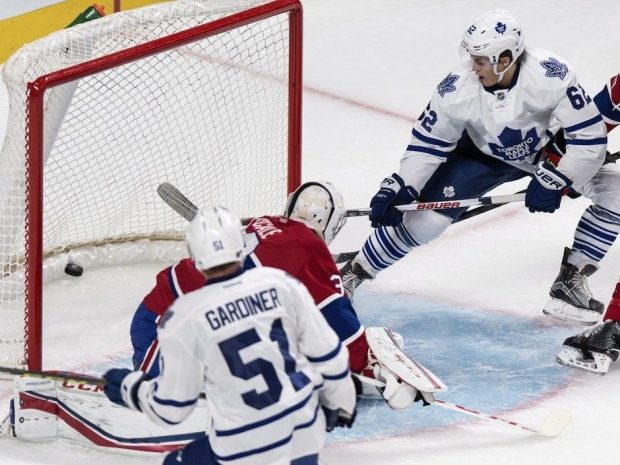 Toronto Maple Leafs' William Nylander, right, scores past Montreal Canadiens goalie Zachary Fucale during second period NHL pre-season hockey action Tuesday, September 22, 2015, in Montreal. THE CANADIAN PRESS/Paul Chiasson