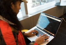 Woman Using Macbook Pro